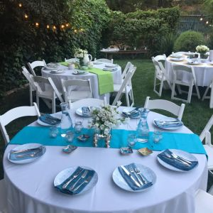 evening outdoor dinner event round tables
